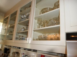 Wooden cabinets with dishware on opposing wall