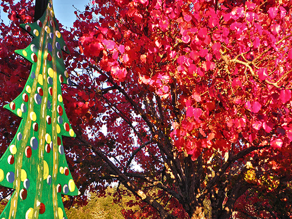 Artsy painted Christmas Tree lamppost with red tree foliage