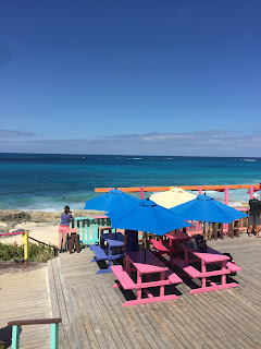 vibrantly painted picnic tables overlooking the ocean
