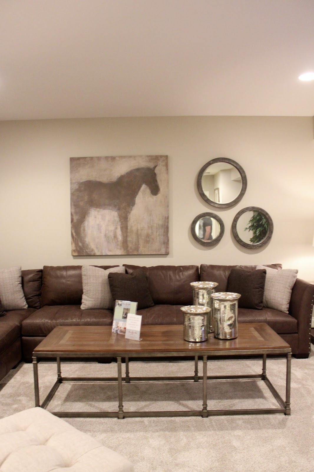 horse canvas and mirror gallery wall
