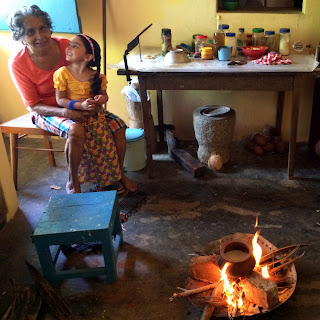 Girl and Grandmother and traditional milk boiling for Sri Lankan New Year