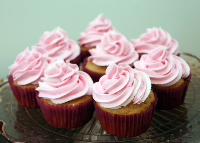 cupcakes with pink buttercream icing