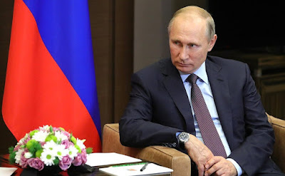 Vladimir Putin at a meeting with President of Kyrgyzstan Almazbek Atambayev.