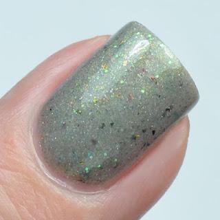 gray nail polish with green shimmer