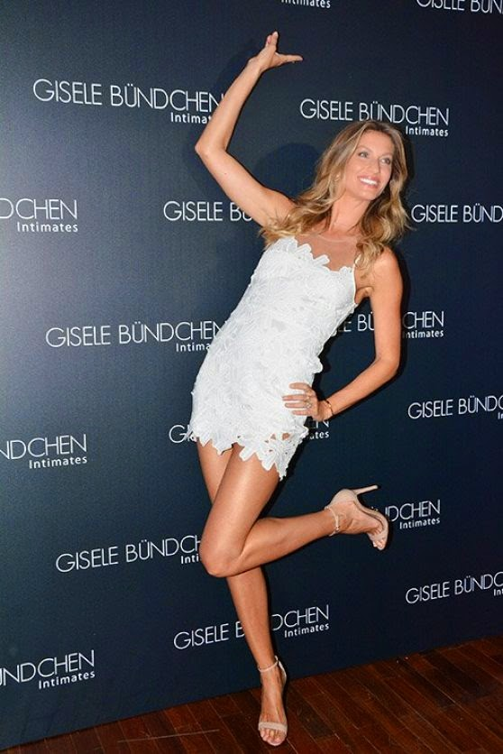 Gisele in a lace white mini dress at launch of Gisele Intimates in Sao Paulo