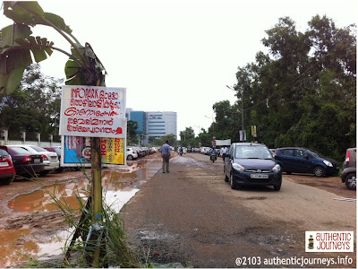 "The sign says, ""Onam Greetings from Infopark Auto Labours. We welcome Maveli to this way"""
