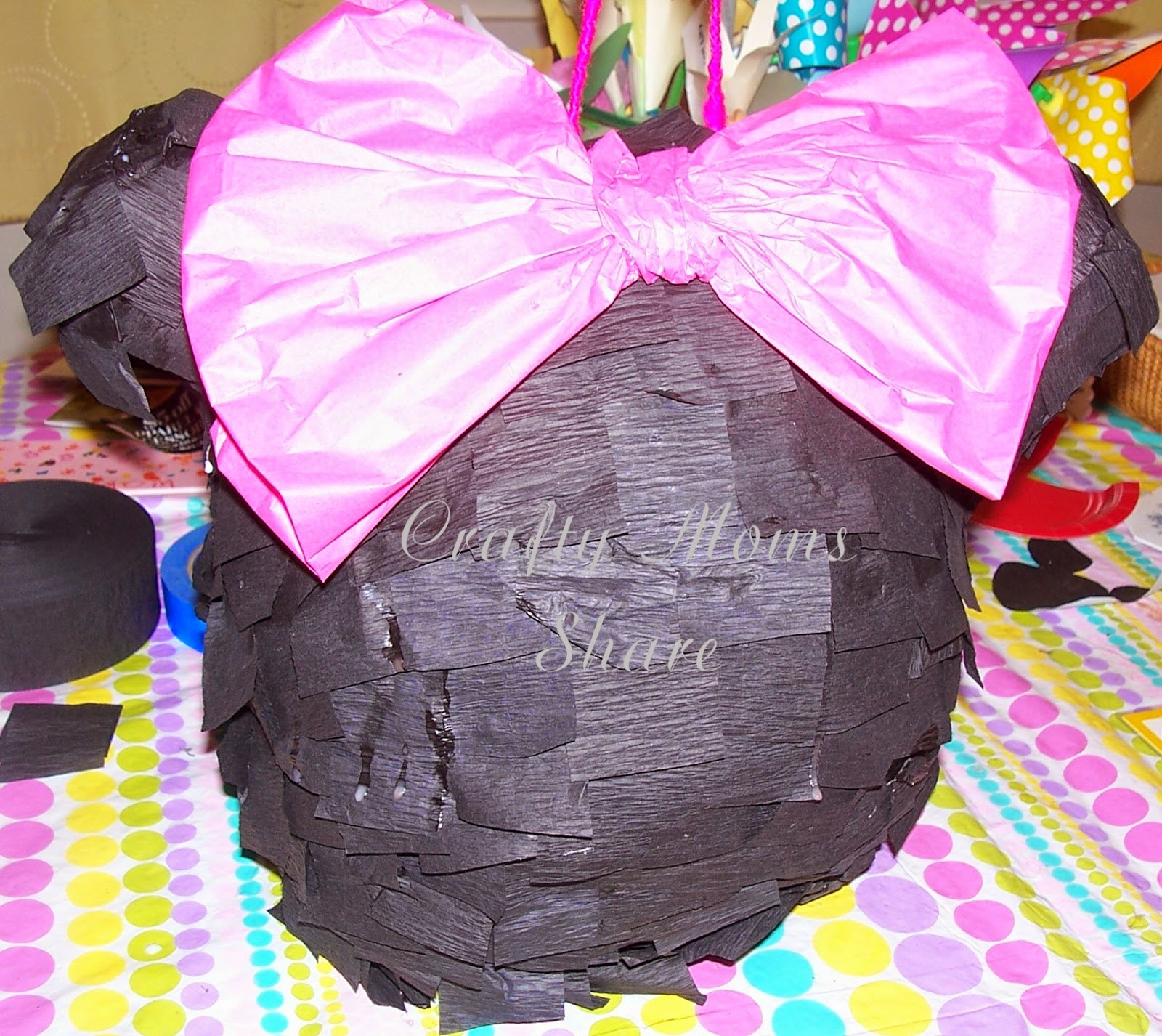http://craftymomsshare.blogspot.com/2014/05/diy-minnie-mouse-pinata-free-party.html