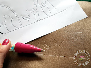 trasferire sul cartoncino con una penna