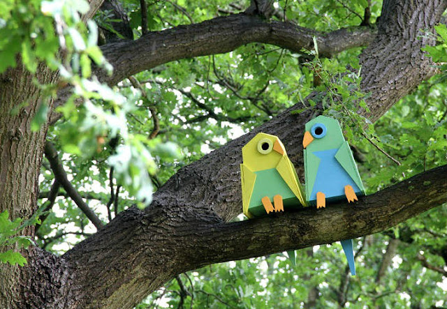 cute birds sculpture on garden trees - garden decor ideas