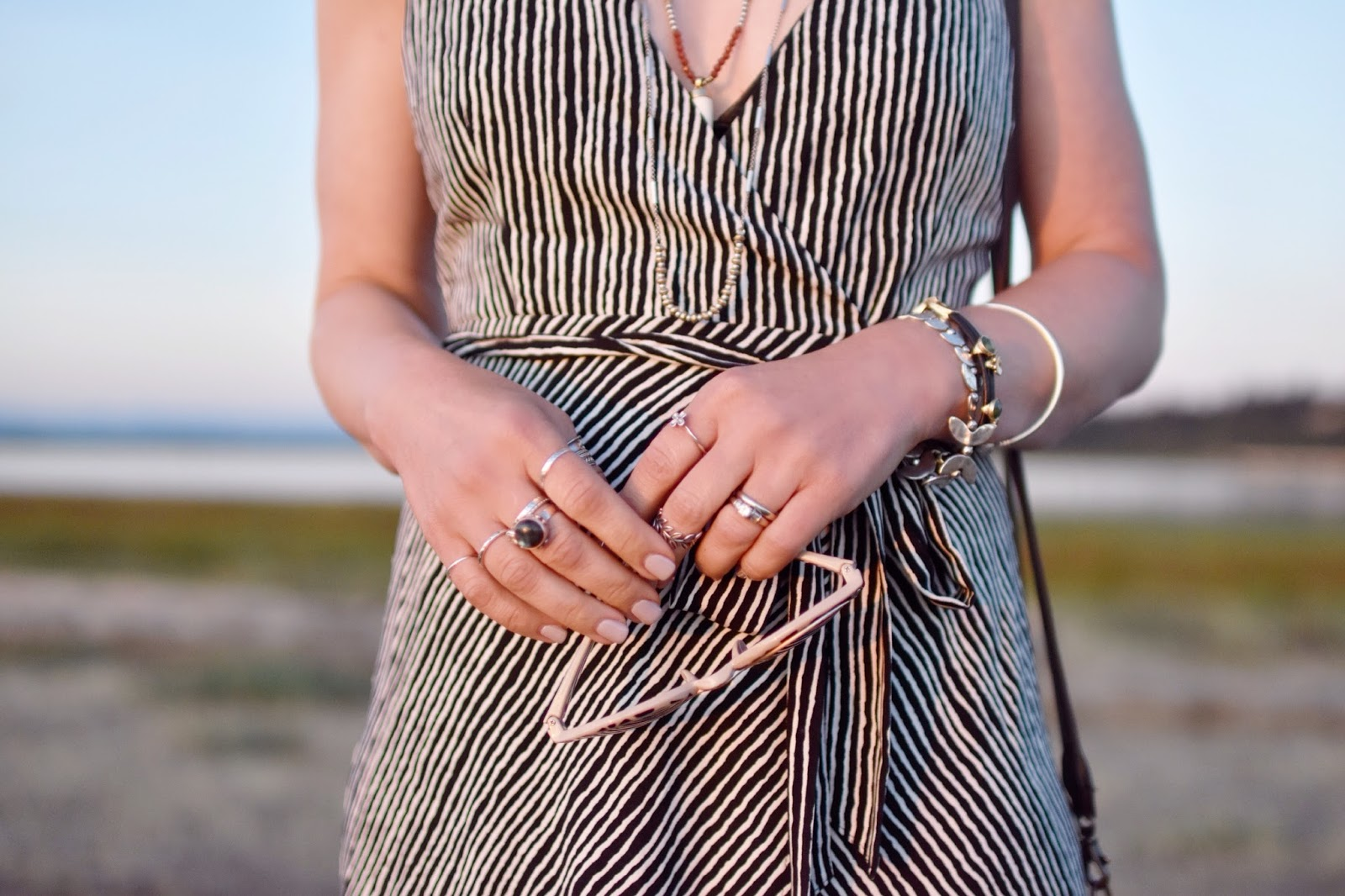 Monika Faulkner personal style inspiration - black and white striped maxi-dress, animal patterned sunglasses, stacked rings