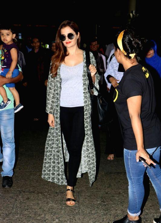 Monica Bedi Stills Without Makeup Face At Mumbai Airport