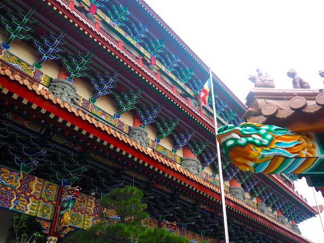 Colourful designs and dragon feature on the exterior of the Hall of Ten Thousand Buddhas, Po Lin Monastery, Ngong Ping, Lantau Island, Hong Kong
