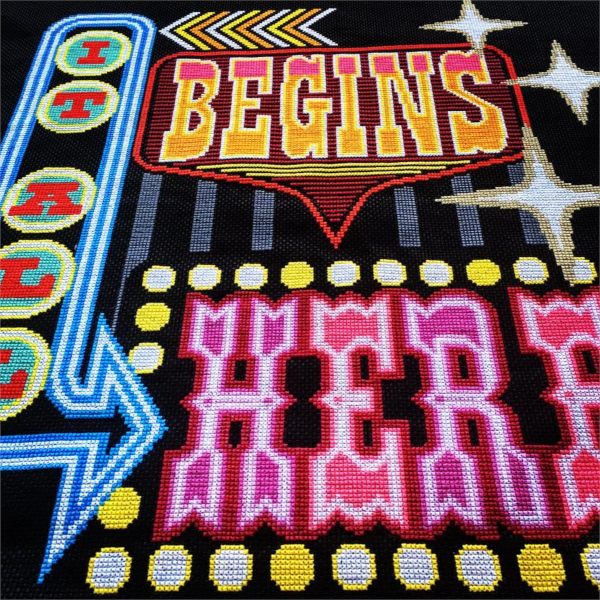 Cross stitch Design of Neon Word Sign 'It All Begins Here' by Emily Peacock