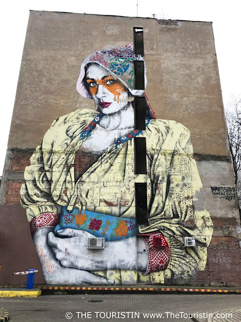 Large mural of a woman created during Street Art Festival in Bratislava in Slovakia