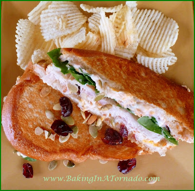 Grilled Holiday Sandwich: Italian Loaf slices topped with a delicious holiday spread, turkey and spinach in the center then pan grilled to a golden brown | Recipe developed by www.BakingInATornado.com | #recipe #Thanksgiving #sandwich