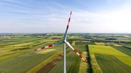 Wind Turbine. Green Summer Landscape