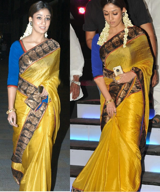 Nayanthara wearing yellow colour silk saree with contrast blue colour three fourth sleeves