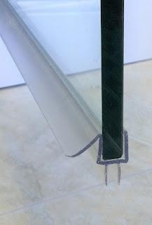 bottom sweep for frameless shower door