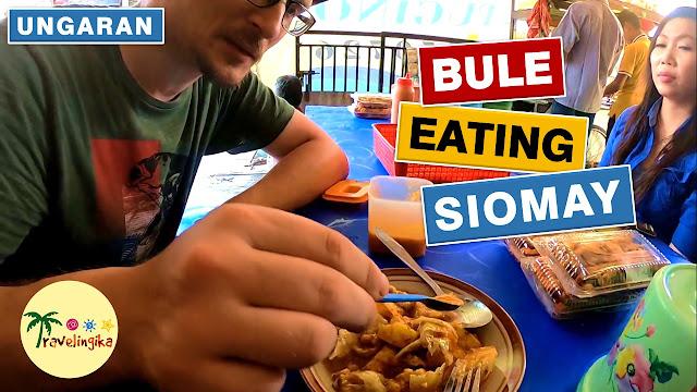 bule makan siomay