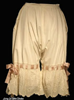 Beige cotton muslin women's pantaloons or bloomers dated 1900 with lace and ribbon trim