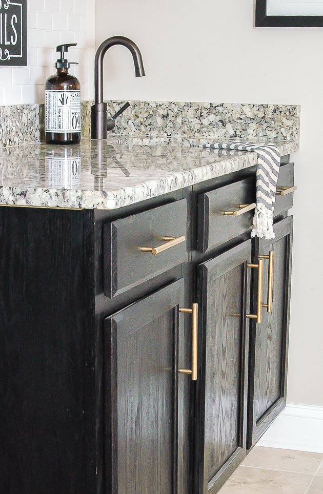 Dark cabinets with gold bar hardware