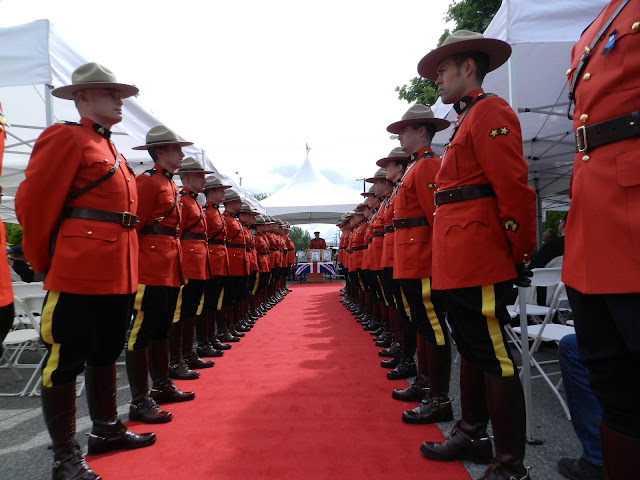 RCMP line the red carpet with the MC at the podium