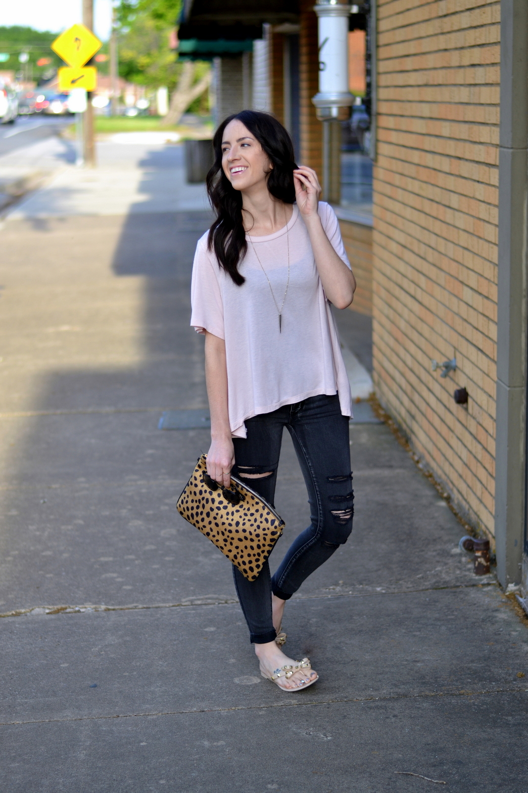 Casual Spring Outfit wearing a loose cotton tee and distressed jeans