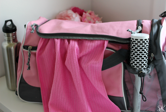 a pink gym bag on a table