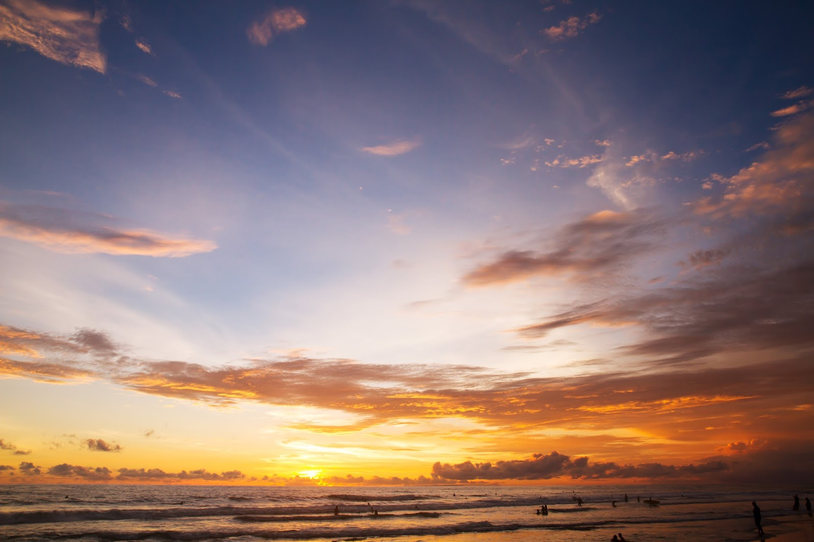 travel blogger, Alison Hutchinson, catching the sunset at Berawa Beach in Canggu, Bali