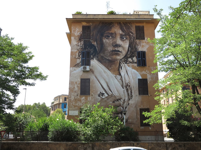 After Ukraine and Kiev, Guido Van Helten is now in Italy where he was invited by the guys from Big City Life to work on a large mural in the district of Tor Marancia, Rome.