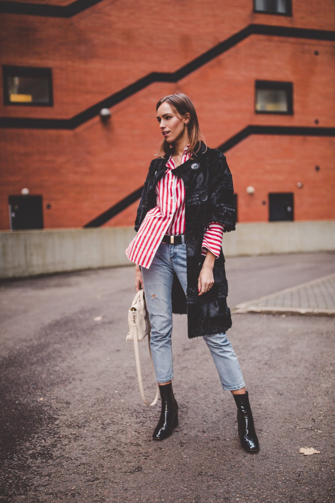 fur coat striped shirt boyfriend jeans boots outfit fall