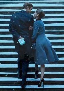 Video still of the couple on the snowy stairs