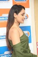 Pragya Jaiswal in a single Sleeves Off Shoulder Green Top Black Leggings promoting JJN Movie at Radio City 10.08.2017 130.JPG