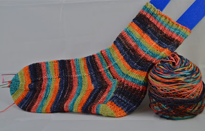 hand knit striped sock with yarn from Knit Knot Studios for https://www.etsy.com/shop/JeannieGrayKnits