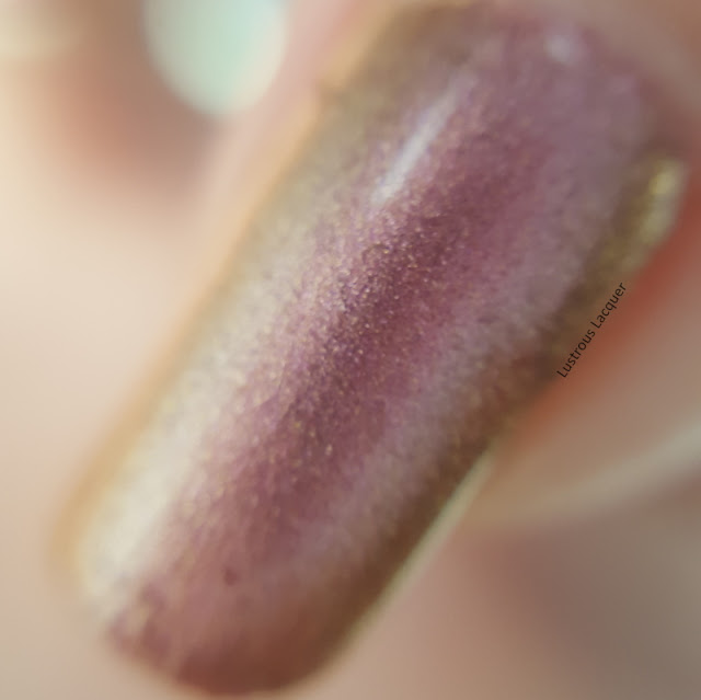 Pink to gold shifting duo-chrome nail polish with a hint of copper.