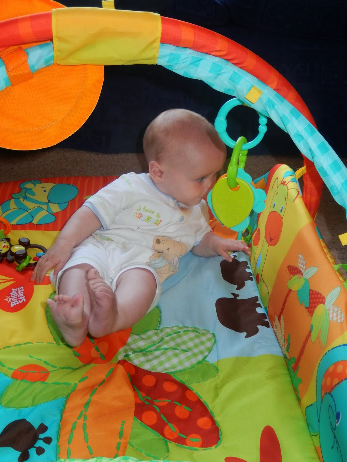 Review Bright Starts Swinging Safari Baby S Play Place