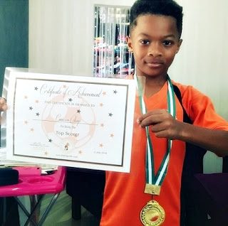 Nigeria base Hiphop singer, Peter Okoye's Son was celebrated as to scorer at his football Academy