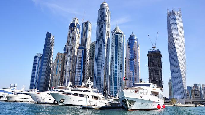 Wallpaper: Skyscrapers and Yachts in Dubai Harbor