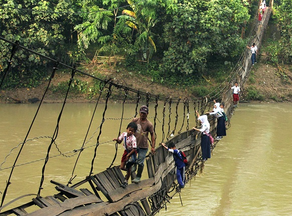 Children Crossing A Damaged Suspension Bridge, Lebak, Indonesia