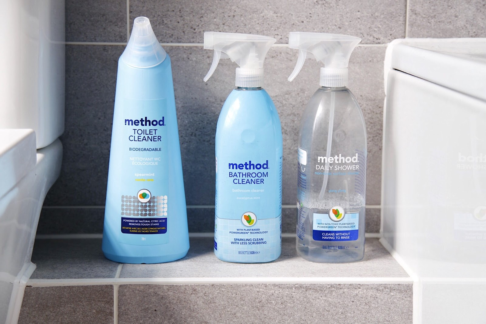 Method Bathroom Household cleaners with grey tile background.