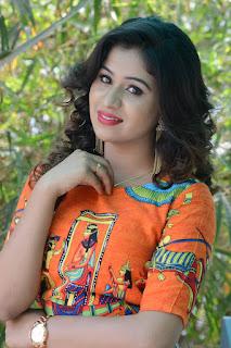 Manali Looks so cute in Long Orange Anarkali Gown at O Sthree Repu Raa Movie Success Meet