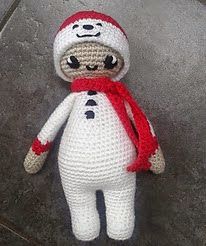 http://www.ravelry.com/patterns/library/noo-noo-doll-in-her-snowman-costume