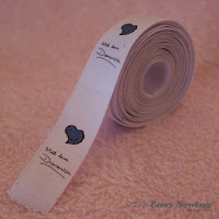 http://www.easysewingforbeginners.com/project/make-fabric-labels-home/