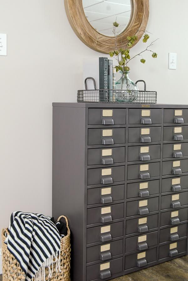 I LOVE this piece!  A vintage metal hardware cabinet gets restored and turned into perfect home storage. www.littlehouseoffour.com