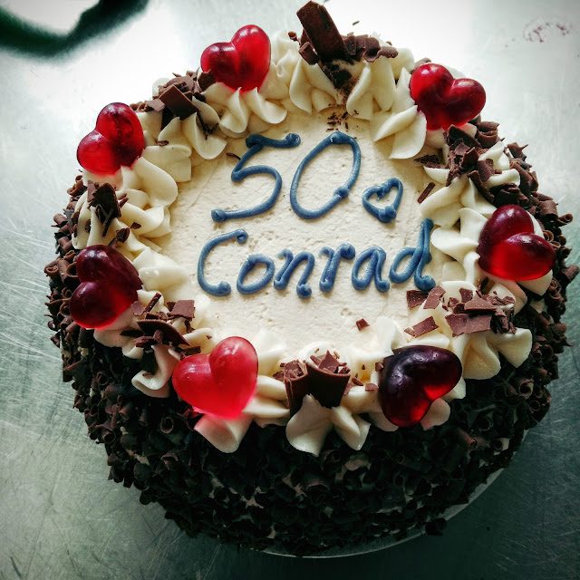 birthday cake with 50 written on top