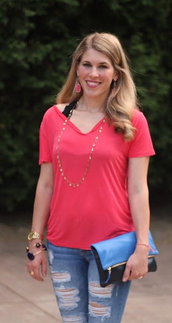 coral top, distressed ankle jeans, blue Clare V. clutch, wedge sandals
