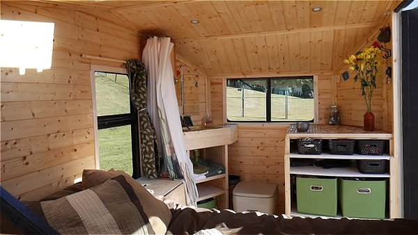 03-Bed-and-Cupboard-Area-Terraform-Tiny-House-on-Wheels-Sustainable-Architecture-www-designstack-co