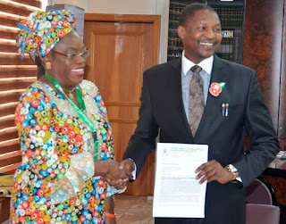 AG. DIRECTOR GENERAL OF NATIONAL AGENCY FOR FOOD AND DRUG ADMINISTRATION AND CONTROL (NAFDAC) MRS. YETUNDE O. ONI, PRESENTING A PAPER TO THE ATTORNEY-GENERAL OF THE FEDERATION AND MINISTER OF JUSTICE, MR. ABUBAKAR MALAMI SAN, ON THURSDAY, 15TH DECEMBER, 2016, AT THE FEDERAL MINISTRY OF JUSTICE, ABUJA