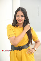 Actress Poojitha Stills in Yellow Short Dress at Darshakudu Movie Teaser Launch .COM 0075.JPG