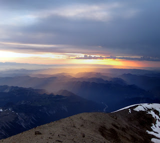 Beautiful sun rays seen from the summit of Mt. Rainier.